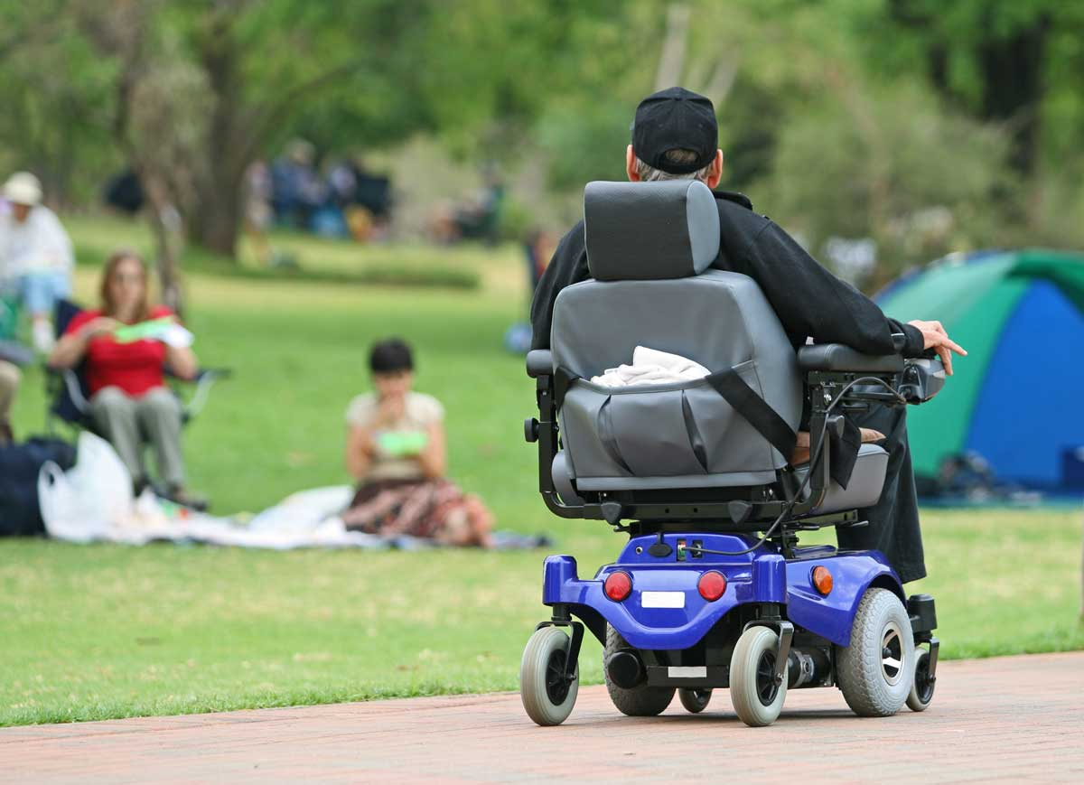man on electric wheelchair in park