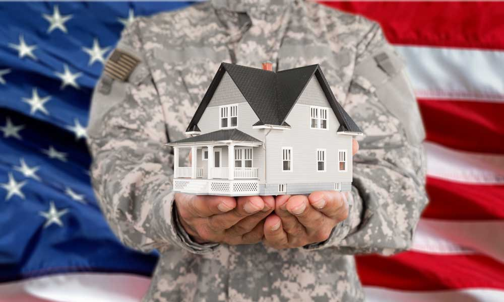 Military man with house model